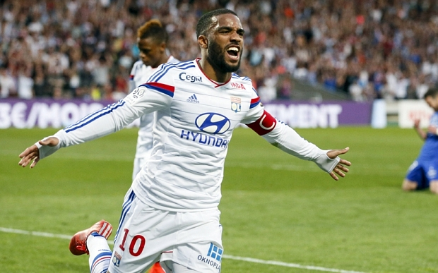 Olympique Lyon's Lacazette celebrates after scoring against Bastia during their French Ligue 1 soccer match at the Gerland stadium in Lyon